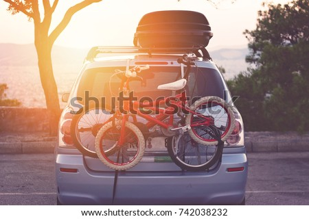 Family car with small kids bicycles rack, ready for travel, making a break on parking Royalty-Free Stock Photo #742038232