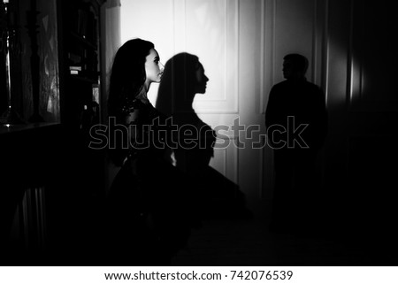 beautiful woman in a black dress with a theatrical mask and handsome man ,sexual foreplay concept #742076539