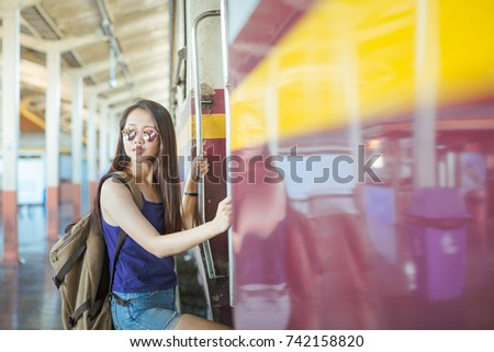 Backpackers girl at a train station #742158820