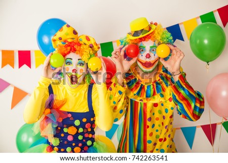 Two cheerful clowns. Birthday for children. Bright clown and clowness. #742263541