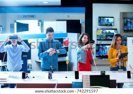Young people buying latest electronics. shopping. Royalty-Free Stock Photo #742291597