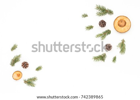 Christmas wood slice decorations, pine cone, spruce branches on white background, flat lay, top view, copy space #742389865