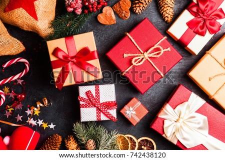 Christmas presents on dark background Royalty-Free Stock Photo #742438120
