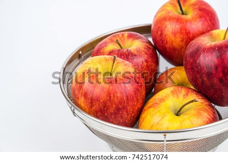 Fresh Apples in Stainless Steel Basket on white background. #742517074