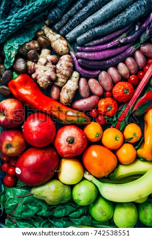 Top view of a composition of Fruits and vegetables typical of the fall season, pumpkin, apple, pepper, black kael. #742538551