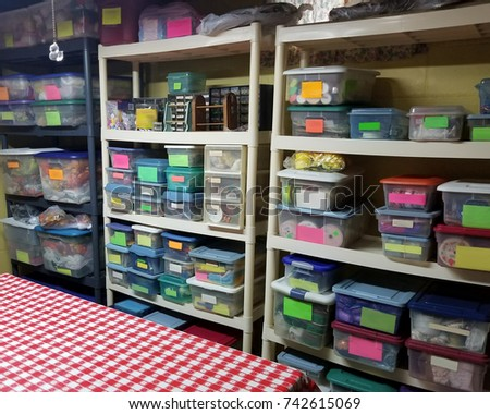 A very organized craft room with lots of containers. #742615069