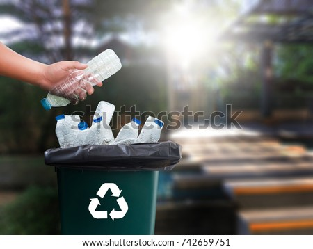 man hand putting plastic reuse  for recycling concept environmental protection world recycle Royalty-Free Stock Photo #742659751