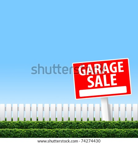 Garage Sale sign on white fence and clear sky
