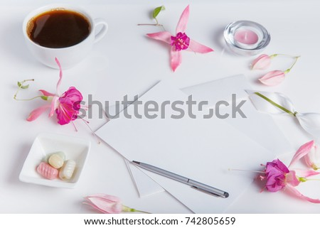 Creative flat lay photo of workspace desk with smartphone, coffee, pencil, flowers with copy space background. Flat lay. #742805659