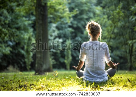 Girl practicing joga in forest #742830037