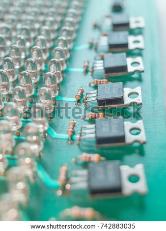 Green Circuit Board with many light diodes in row, and transistors #742883035