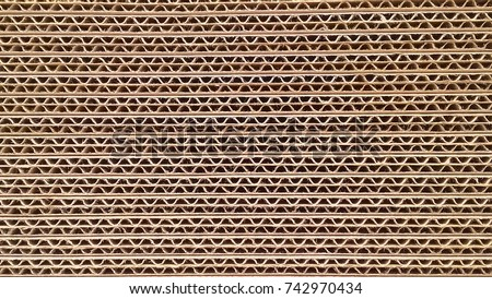 corrugated cardboard for packing. abstract background horizontal lines with wavy lines of beige color Royalty-Free Stock Photo #742970434