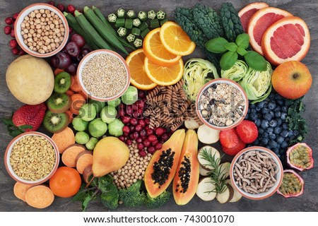 Vegan health food concept for a high fibre diet with fruit, vegetables, cereals, whole wheat pasta, grains, legumes & herbs. Foods high in antioxidants, s & vitamins. Immune boosting. Flat lay. #743001070
