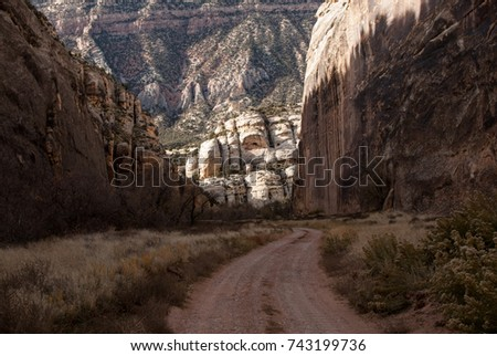 Dirt road in the bottom of the sandstone cliffs. #743199736