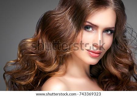 Beautiful hair woman beauty skin portrait over dark background. Long beautiful healthy hair model girl stock image. #743369323