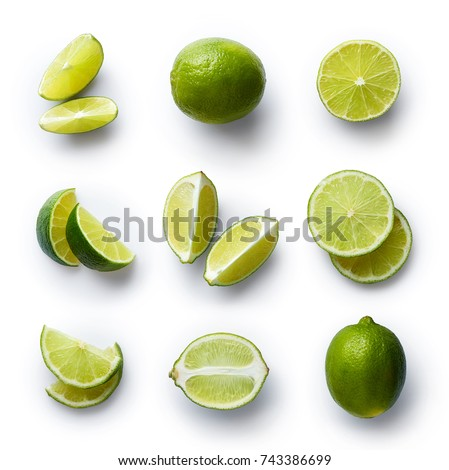 Set of fresh whole and cut lime and slices isolated on white background. From top view #743386699