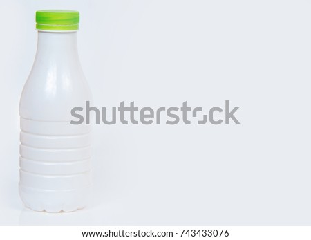 White bottle with green cover on white background #743433076