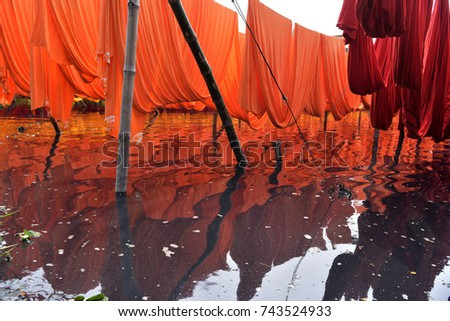DHAKA, BANGLADESH - OCTOBER 28, 2017:  Garments fabric in the sun at Narayanganj, near Dhaka, Bangladesh on October 28, 2017. #743524933