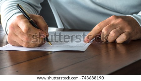 Completing a medical form Royalty-Free Stock Photo #743688190