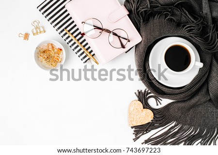 Workspace with golden maple leaves, notebook, coffee cup wrapped in scarf,  glasses. Stylish office desk. Autumn or Winter concept.  Flat lay, top view #743697223