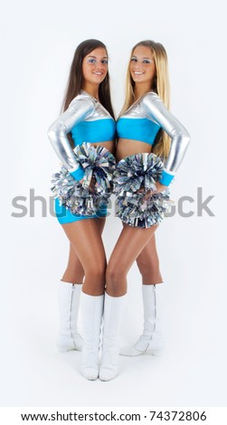 Picture of two young and attractive cheerleaders.