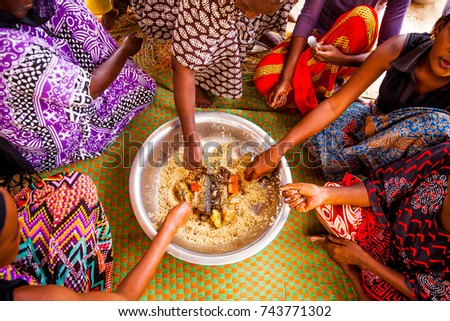 Women eating together in Senegal in the traditional manner. #743771302