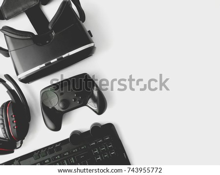 gamer workspace concept, top view a gaming gear, keyboard, joystick, headset, VR Headset on white table background with copy space.