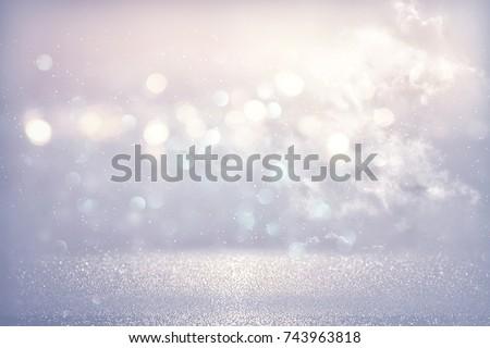 glitter vintage lights background. light blue and silver. de focused #743963818