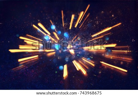 abstract bokeh background of golden light burst made from bokeh motion Royalty-Free Stock Photo #743968675