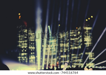 Defocused entertainment concert lighting on stage, blurred disco party and Concert Live #744116764