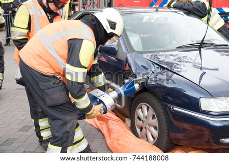 Bergen, Noord Holland / The Netherlands - October 28th 2017 : Open day at the local fire brigade station. Image shows a demonstration cutting open an automobile after a road traffic accident. #744188008