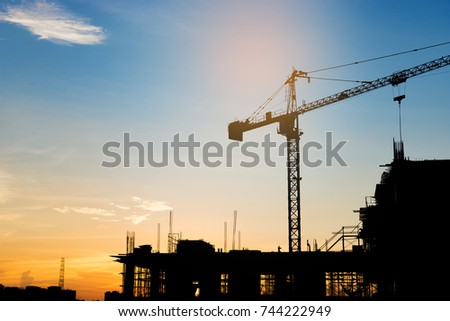 Silhouette of building under construction on sunset #744222949