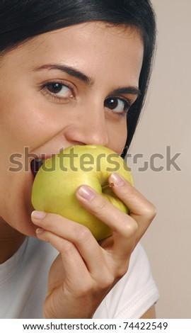 Young woman eating fresh apple. #74422549