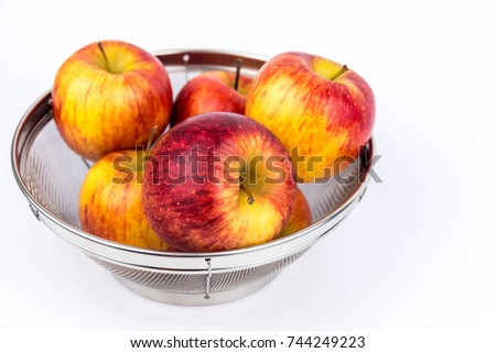 Apples in Stainless Steel Basket Isolated on white background. #744249223