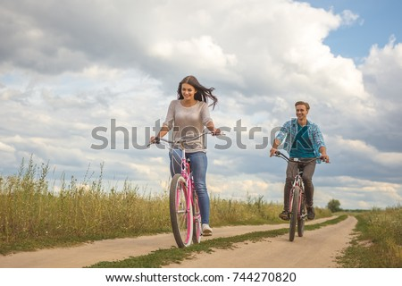 The happy couple riding a bike outdoor #744270820