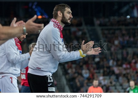ZAGREB, CROATIA - OCTOBER 28, 2017:  Friendly handball game between National representation of Croatia and Slovenia. Mirko ALILOVIC (25) clapping hands for good game of his teammates   #744291709
