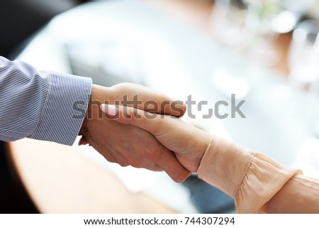 Two Businesspeople Meeting For Lunch In Restaurant #744307294