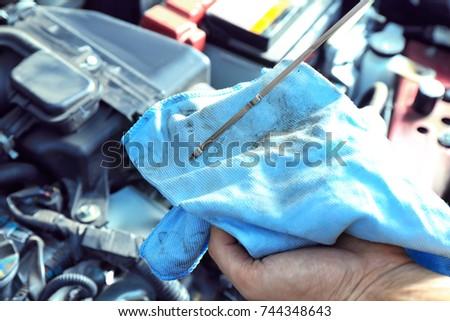 Car mechanic providing car service, closeup #744348643