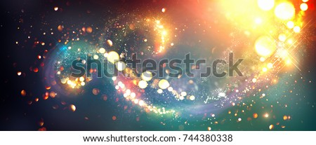 Golden Christmas and New Year glittering stars swirl bokeh background, backdrop with sparkling golden stars, holiday garland, magic glowing dust, lights. Vintage Gold Abstract Glitter Blinking sparks Royalty-Free Stock Photo #744380338