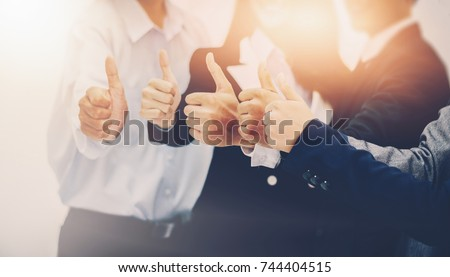 Business team showing many thumbs up expressing positivity successful teamwork and cooperation purposiveness same intention organization concept optimistic thinking trust  self belief Decide #744404515