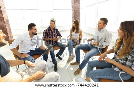 team sitting in a lesson on team building #744420241