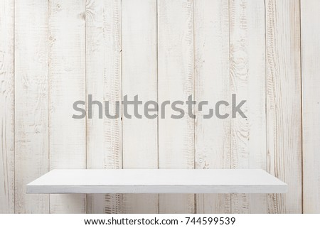 white shelf on wooden wall background texture Royalty-Free Stock Photo #744599539