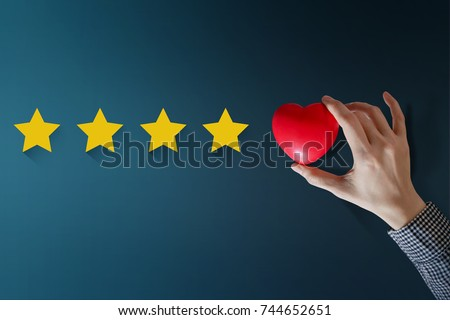 Customer Experience Concept, Best Excellent Services Rating for Satisfaction present by Hand of Happy Client put a Heart on Five Star Royalty-Free Stock Photo #744652651