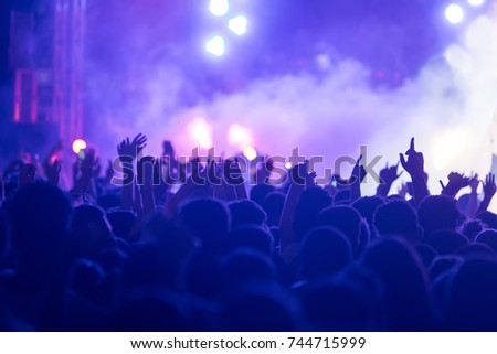 Hand with a smartphone records live music festival, Taking photo of concert stage, live concert, music festival, happy youth, luxury party, landscape exterior #744715999