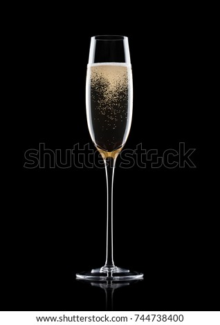 Champagne glass with bubbles with reflection on black background #744738400