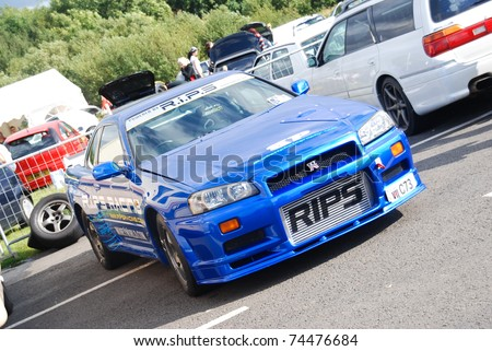 NORTHANTS, ENGLAND - AUG 2: Blue Nissan Skyline GTR on display at the Annual Ultimate Street Car Show on August 2, 2008 in Northants, England, UK. Santa Pod is host to the show #74476684