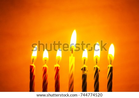 The symbol of the traditional holiday Kwanzaa seven candles for the background.