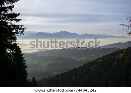 View from mountains with cloudy inversion below. Slovakia #744845242