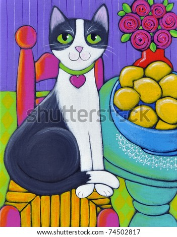 A black and white cat sitting next to a table that has a big blue bowl full of lemons on it. She is wearing a collar with a heart