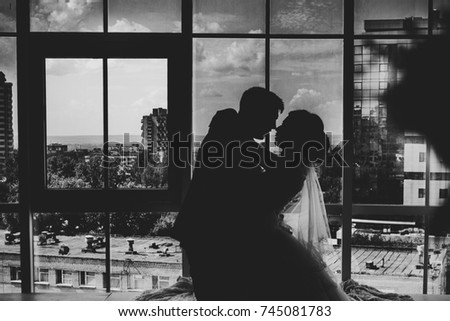 black white photo bride and groom on background clear windows. #745081783